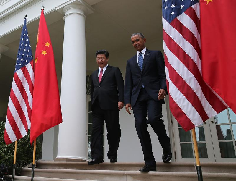 U.S. President Barack Obama and Chinese President Xi Jinping arrive to a joint news conference in Washington D.C.