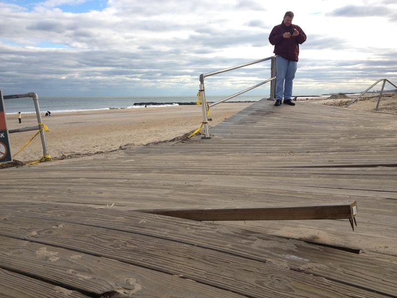 At first, Ocean Grove, N.J., failed to qualify for federal aid to repair its boardwalk. Above, a passerby surveyed the damage shortly after Sandy.