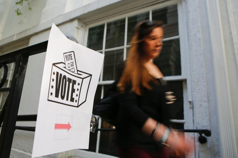 A woman arrives at a polling station to cast her ballot during Pennsylvania State primary presidential election on April 26, 2016 in Philadelphia, Pennsylvania.
