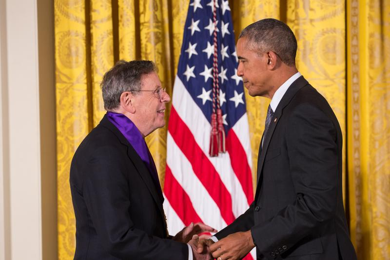 Philip Glass receiving a 2015 National Medal of Arts from President Barack Obama