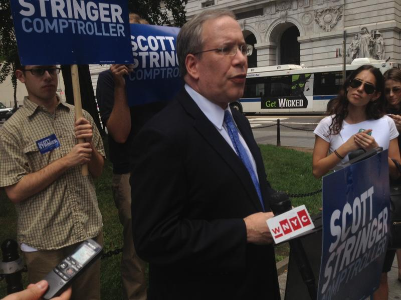 Manhattan Borough President Scott Stringer talks to reporters about his campaign for city comptroller against former Governor Eliot Spitzer.