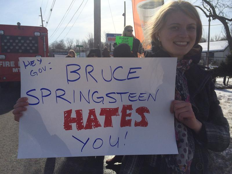 A protestor outside a Chris Christie town hall meeting in Middletown, NJ