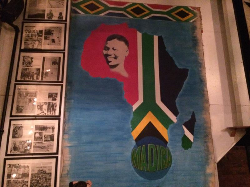 Nelson Mandela mural and newspaper clippings at Madiba restaurant in Fort Greene, Brooklyn