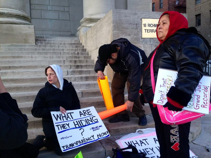 Protesters on the steps of Richmond County Supreme Court on Staten Island try to pressure a judge to release details in Eric Garner's grand jury proceedings.