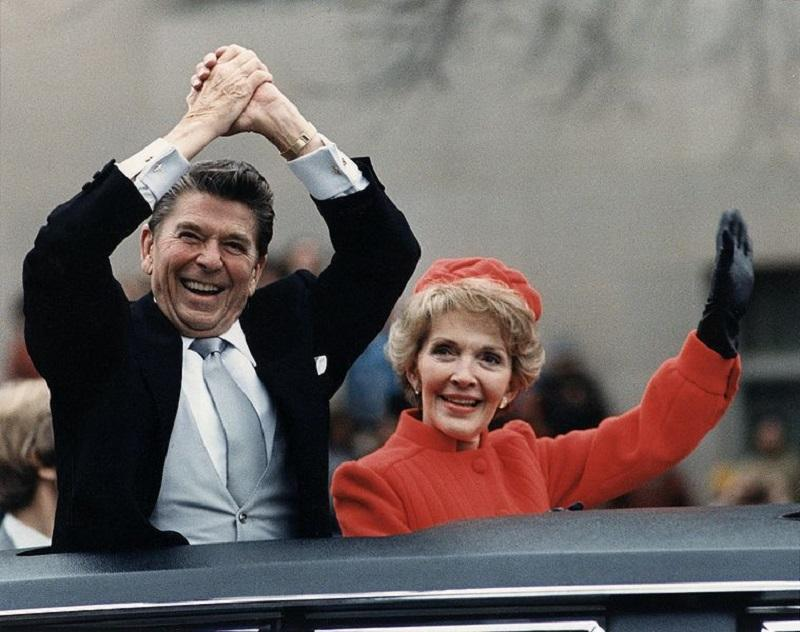 Ronald Reagan and Nancy Reagan waving from the limousine during the Inaugural Parade in Washington, D.C. on Inauguration Day, 1981.