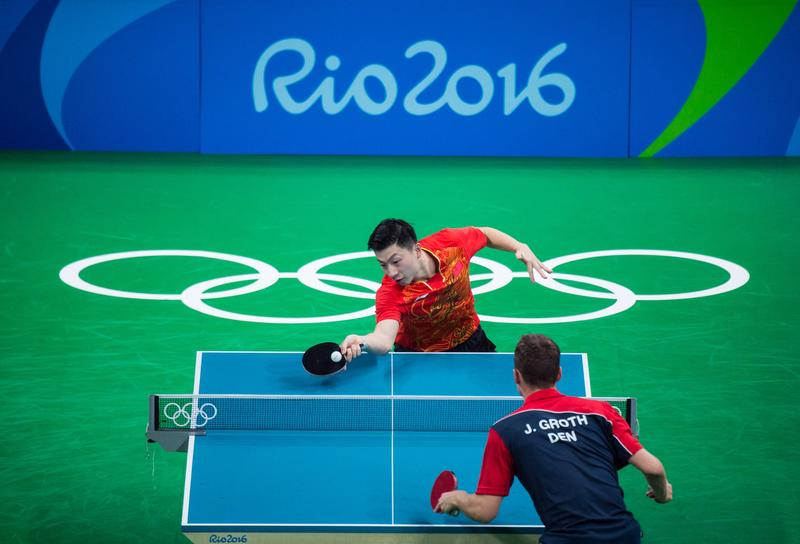 Long Ma of China in action against Jonathan Groth of Denmark during men's singles third round match on second day of the Rio 2016 Olympic Games in Rio de Janeiro, Brazil on August 7, 2016.