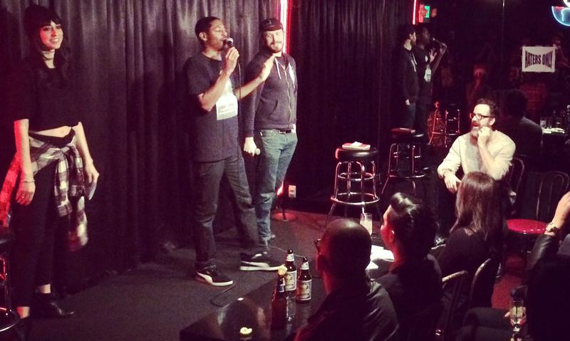 Host Brian Moses stands between two warring comics at the Comedy Store's Roast Battle