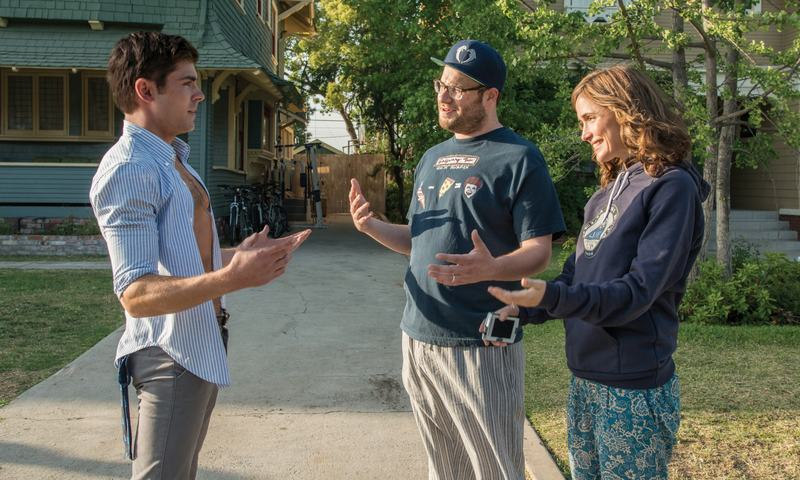(Left to right) Zach Efron, Seth Rogen, and Rose Byrne in <em>Neighbors</em>