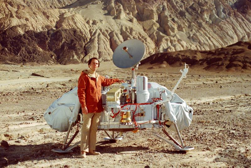 "Carl Sagan, host of the original ""Cosmos,"" with a model of the Viking lander."