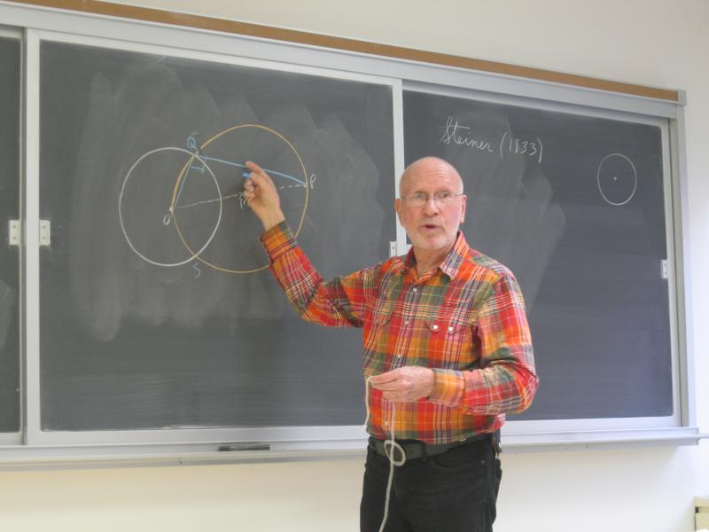 Gil Kessler teaches a course to New York City math teachers.