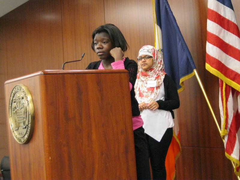 Salice Obosu and her partner Shangida Haque, both 7th graders at M.S. 22 in the Bronx, take questions from a panel of judges after presenting legal arguments on a search and seizure case.