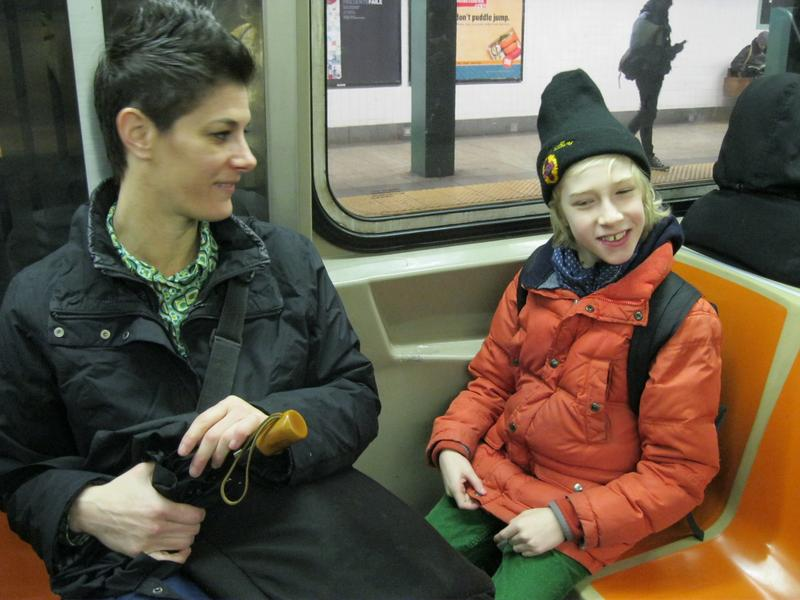 Lori Podvesker and her son, Jack, take the G train to school.