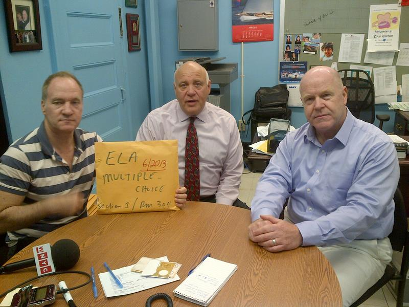 Chelsea Career and Technical Education High School's (from left) assistant principal Robert Mitchell, principal Brian Rosenbloom and government teacher Michael Morrison who say they're angry about the