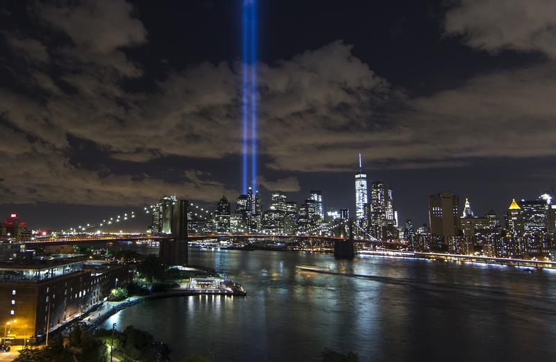 Tribute in Light illuminate the New York City sky between the Twin Towers of the World Trade Center in New York to mark the 14th anniversary of the 2001 terrorist attacks on September 11, 2015.