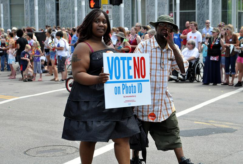 Supporters of a No Vote on Photo ID march on June 24, 2012, in Minneapolis.