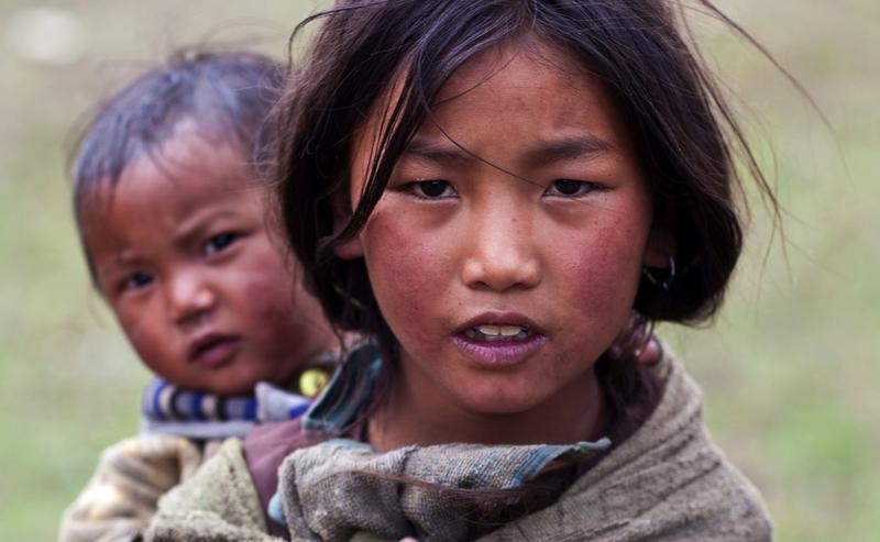Tibetan girl Ningma Dolkar, 9, from the village of refugees poses for the photo during the Dho Tarap Full Moon Festival on September 10, 2011 in Dho Tarap, Upper Dolpo, Nepal