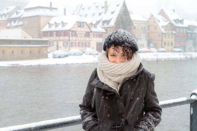 Female Student from Sicily, shot in front of the river Regnitz in Bamberg on a snowy day in Germany in Winter.