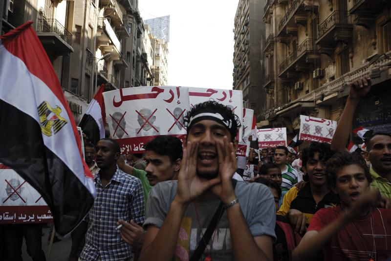 Unidentified anti-Muslim Brotherhood/Morsi protesters in Tahrir Square shout slogans calling for Morsi's resignation on June 30, 2013 in Cairo, Egypt.