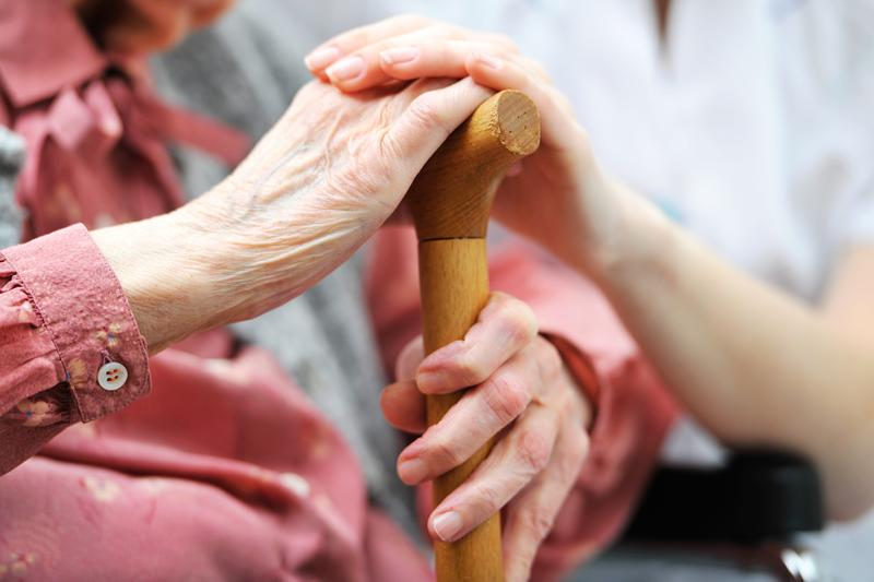 A senior with a home caregiver.