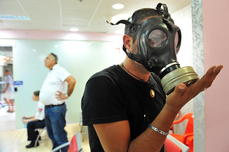 An Israeli man testing gas mask on April 06 2010. At the time there were reports of a possible American attack in Syria that caused a sharp rise in the number of Israelis seeking gas masks.