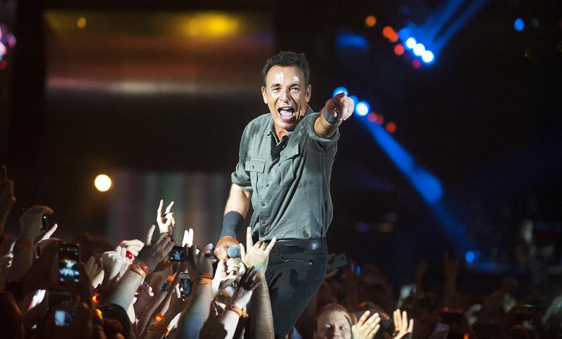 RIO DE JANEIRO, BRAZIL - SEPTEMBER 21: US singer Bruce Springsteen performs among the audience during the Rock in Rio 2013 concert, on September 21, 2013