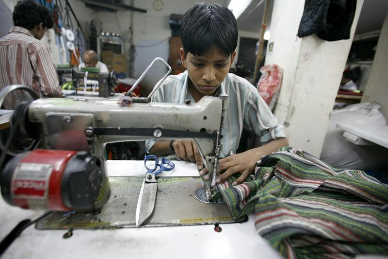 A young worker in a small factory in Old Delhi. February 2008.