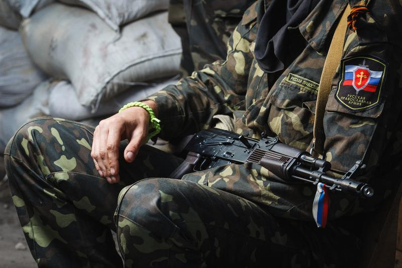 Machine gin in the hands of one of the fighters at the Russian Orthodox Army's block post on the road to the airport on June 01, 2014 in Donetsk.