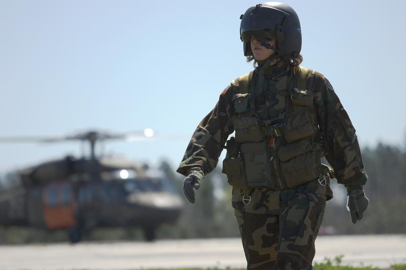 A pilot walks away from her Blackhawk.