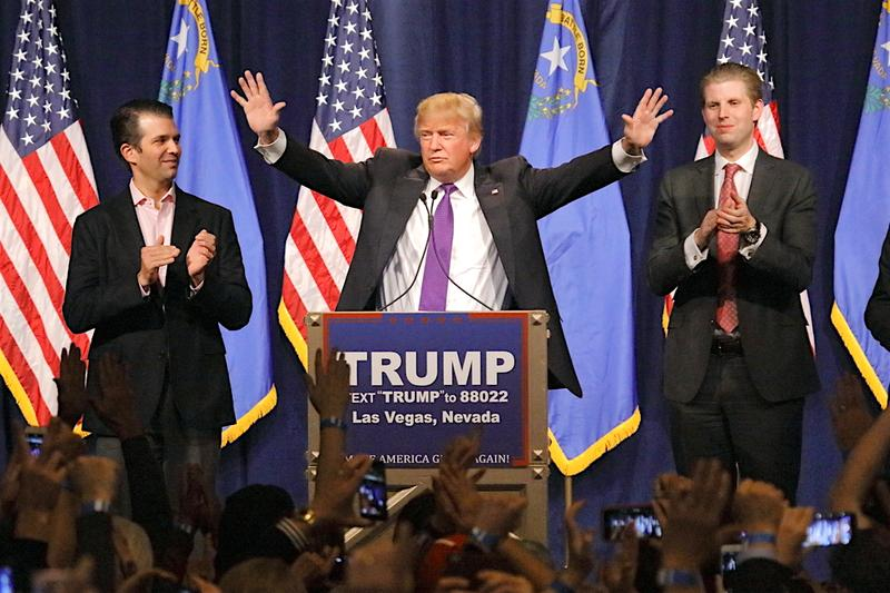 LAS VEGAS, NV - FEBRUARY 23, 2016: Donald Trump is flanked by sons Eric (Right) and Donald Jr. (Left) during Mr. Trump's victory speech after Nevada caucus, Las Vegas, NV.