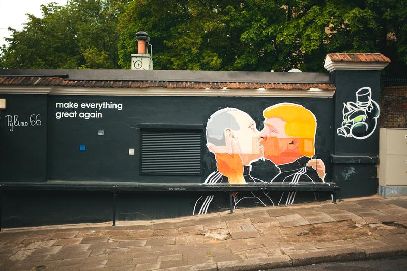 Vilnius, Lithuania - May 21, 2016: Russian President Vladimir Putin and U.S. presidential hopeful Donald Trump are kissing on the side of a barbecue restaurant in Vilnius, Lithuania.