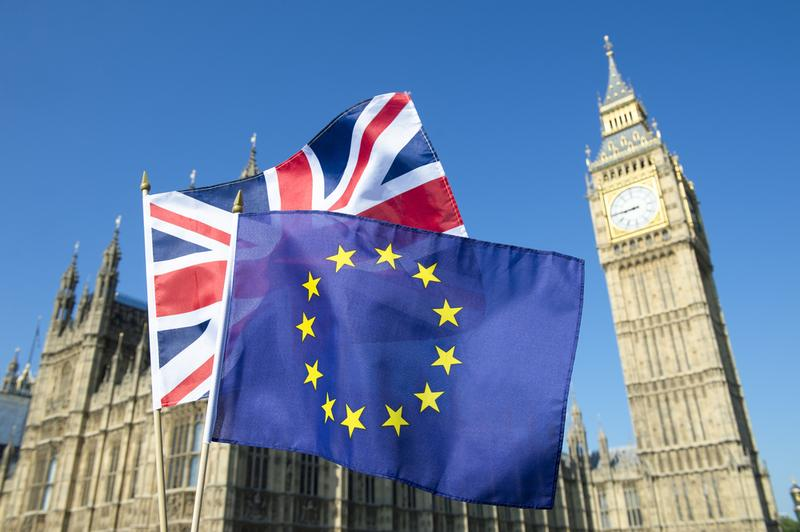 European Union and British Union flag flying in front of Big Ben and the Houses of Parliament at Westminster Palace, London.