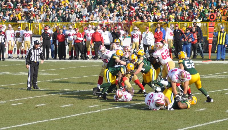 Green Bay Packers defense gang tackling in a game at Lambeau Field against the San Francisco 49ers on November 22, 2009 in Green Bay, WI.
