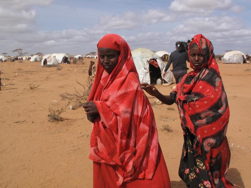 Unidentified woman & children live in the Dadaab refugee camp where thousands of Somalis wait for help. August 15, 2011 in Dadaab, Somalia.