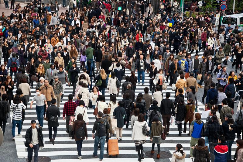 Unidentified pedestrians at Shibuya crossing on November 20, 2010 in Tokyo, Japan. The famous scramble crosswalk is used by over 2.5 million people daily.