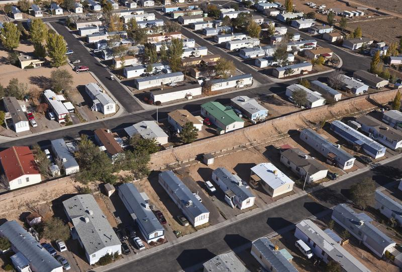 Aerial of mobile homes in the bright desert sun.