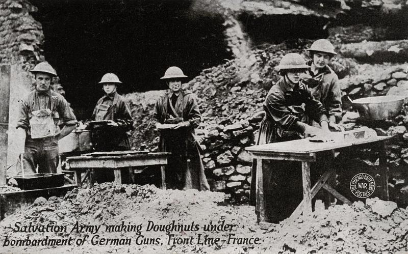 Salvation Army making Donuts - postcard depicting Salvation Army making donuts under bombardment of German guns while in front line in France during WWI, circa 1914-1918.