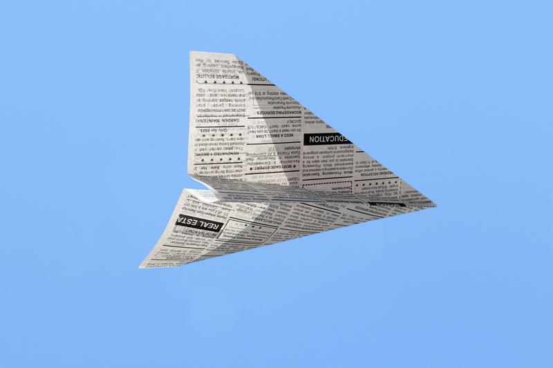 Newspaper paper airplane