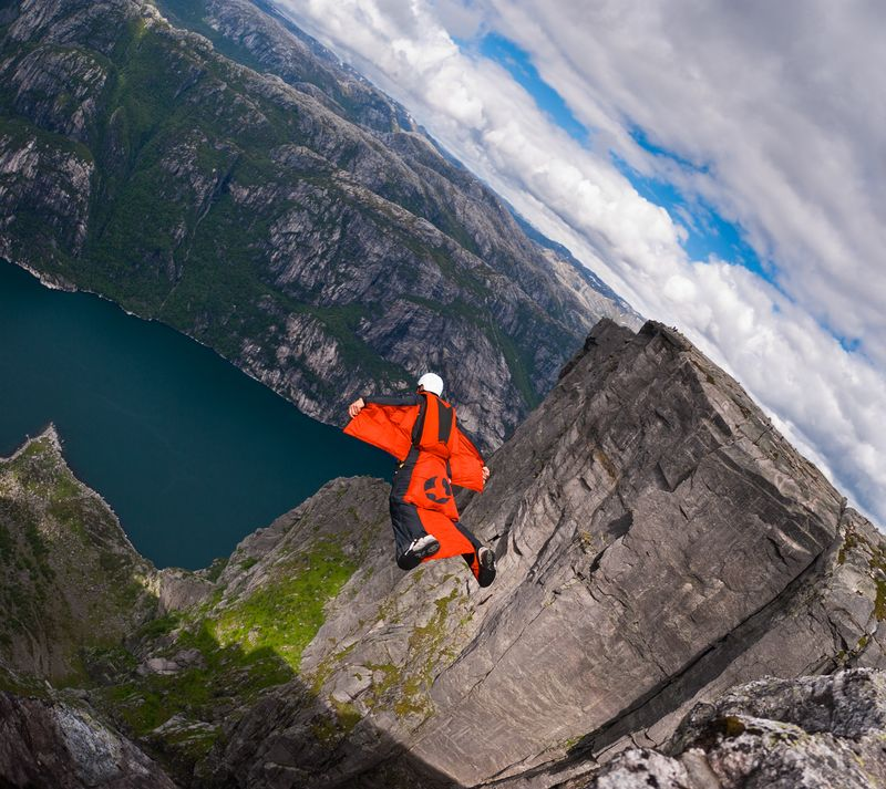 A B.A.S.E. jumper in wingsuit jumps off a cliff August 21, 2010, in Kjerag, Norway. Wingsuit cliff jumping is an advanced discipline, it makes human flight possible.
