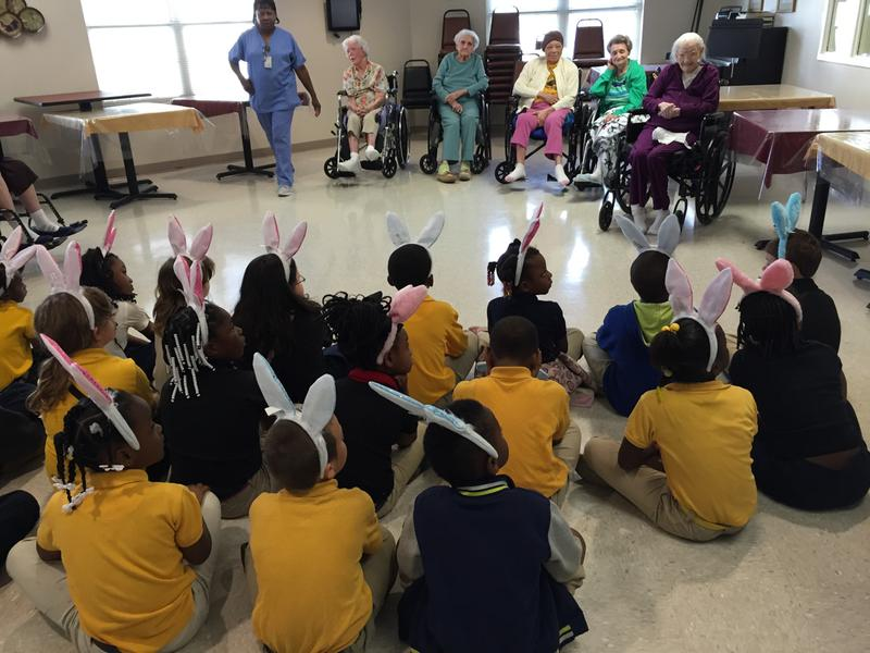 Students from Charleston Elementary School wait to meet seniors with Alzheimer's and dementia inside Tallahatchie General Hospital.