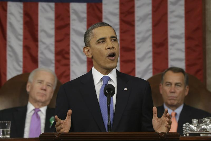 President Barack Obama, flanked by Vice President Joe Biden and House Speaker John Boehner of Ohio, as he delivers his State of the Union address.