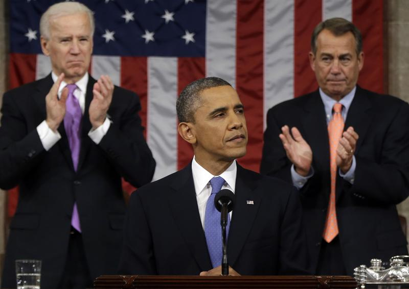 U.S. President Barack Obama, flanked by Vice President Joe Biden and House Speaker John Boehner (R-OH), delivers his State of the Union speech. Feb. 12, 2013