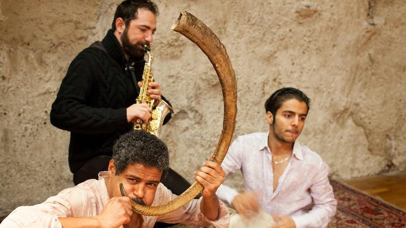 Saeid Shanbehzadeh (Iranian bagpipe), Basel Rajoub (saxophone), and Naghib Shanbehzadeh (percussion)