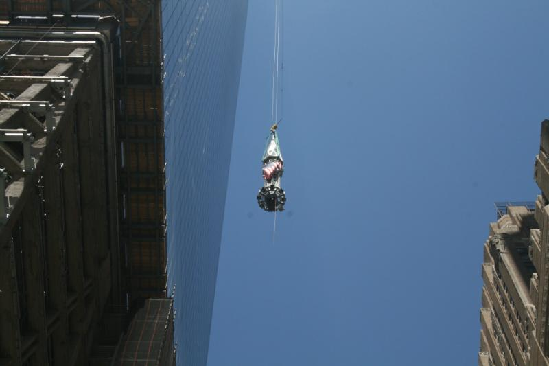 A 408-foot spire was hoisted onto One World Trade Center.
