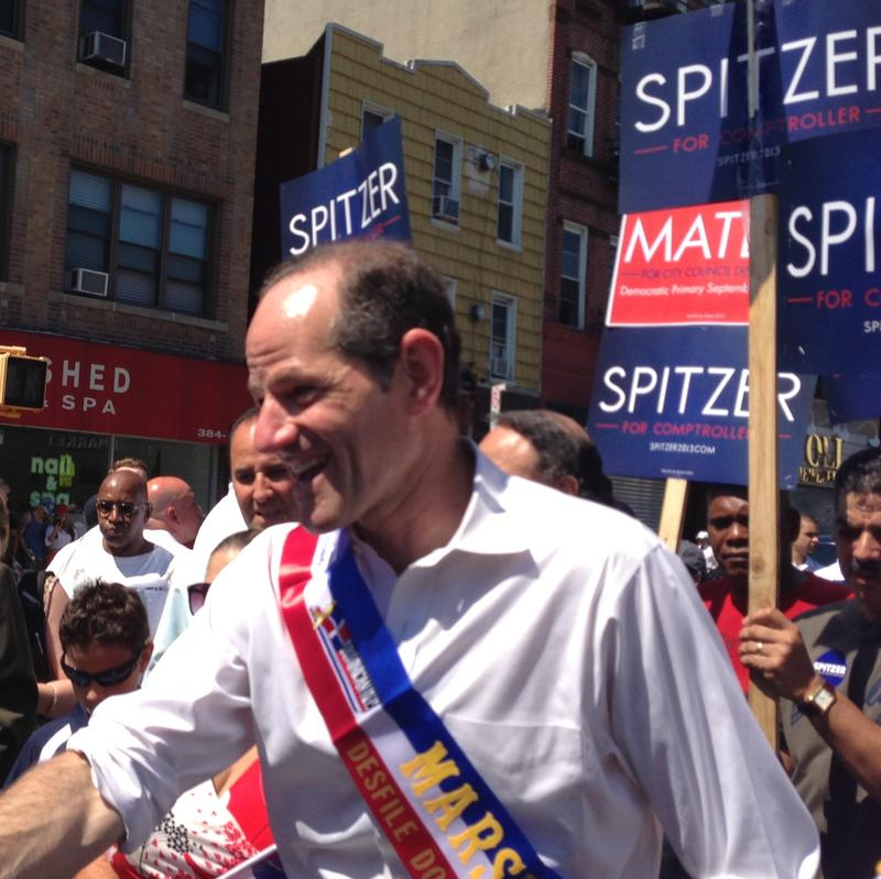 Eliot Spitzer addresses supporters in Harlem