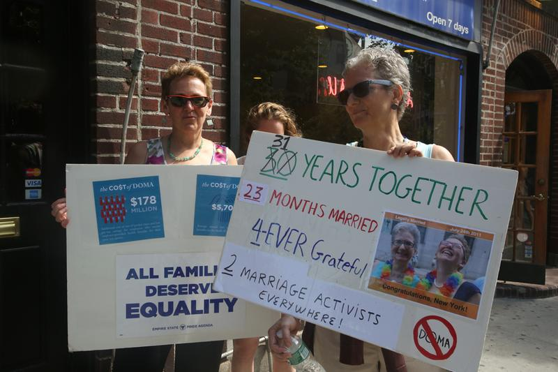 Brooklyn's Jo-Ann Shain Shain and Mary Jo Kennedy, one of the plaintiff couples in the case legalizing marriages for same-sex couples in New York, celebrate the DOMA ruling outside the Stonewall Inn.