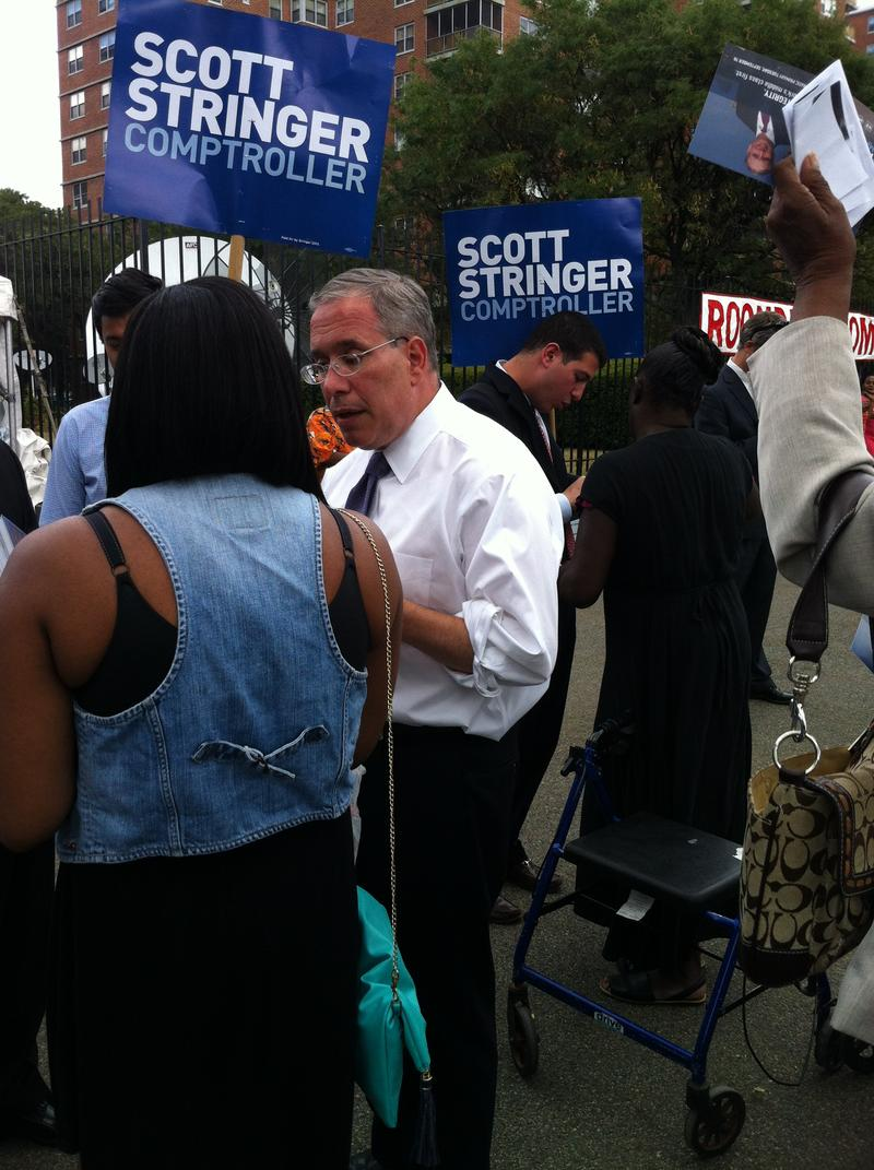 Scott Stringer talks to possible voters at the Rochdale Village fall festival.