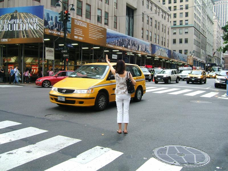 Hailing a yellow cab in Midtown - the old-fashioned way