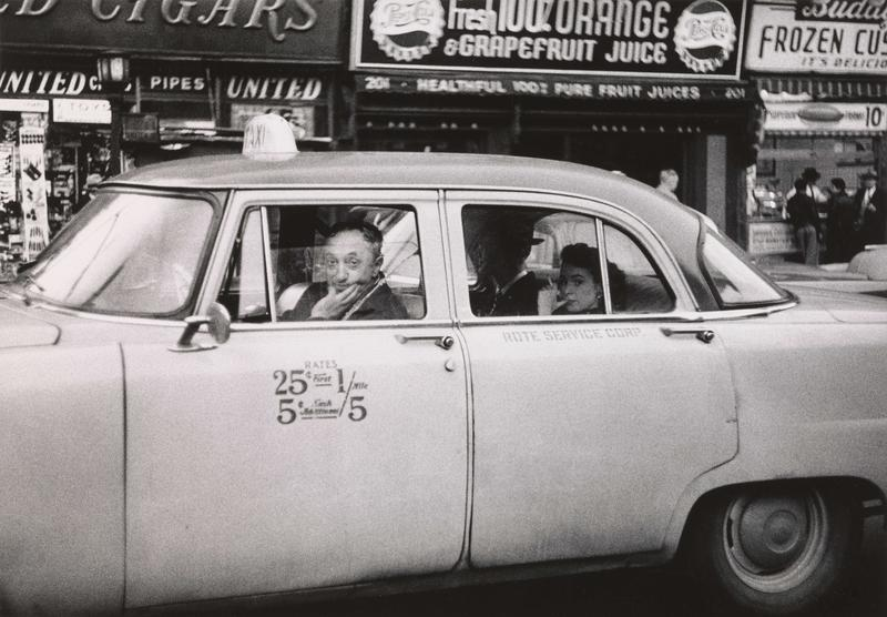 Taxicab driver at the wheel with two passengers, N.Y.C. 1956
