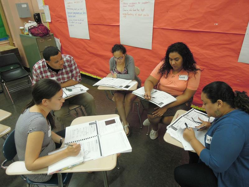 Elementary school teachers attend a summer training on a new English language arts curriculum developed by Pearson.