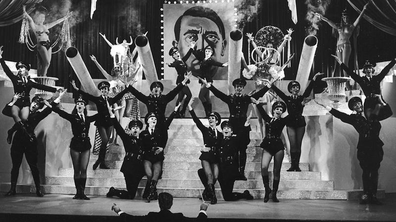 """Springtime For Hitler"" from Mel Brooks film and Broadway musical The Producers is likely the funniest song to deal with Hitler."